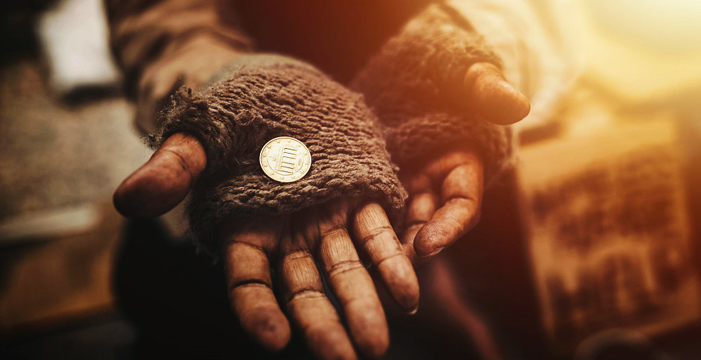 a hand with a coin
