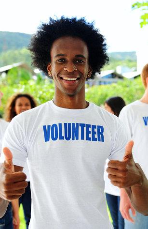volunteer gesturing a thumbs up