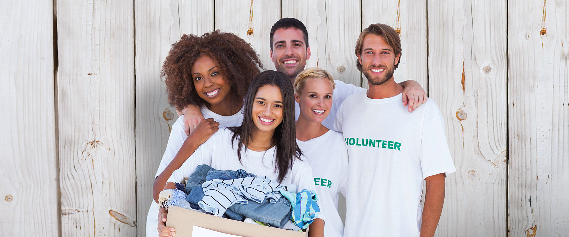 volunteers having a box of clothes